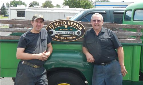 photo of Ray and Sam Jadzak from PJ Auto Repair in front of their greeen 1954 International Pickup Truck